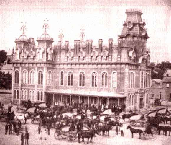 "This is the Market Square as it looked in the ""grand old days"". Not only were vendors set up inside, but some chose to sell off the back of their wagons."